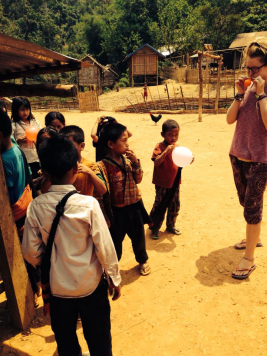 Blowing up balloons at a school in rural Laos